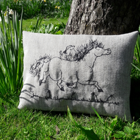 Lottie and Basil go for a trot - free motion embroidered cushion.