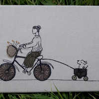 Sybil takes Lottie for a ride - free motion embroidered wall art.