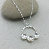 Silver and 9ct Gold Dome and Circle Pendant