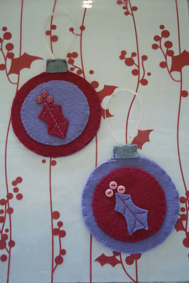 Pair of bauble shaped felt handstitched Christmas decorations