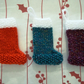 Set of three knitted Christmas mini stockings.