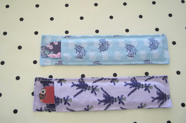 Pair of fabric nail file holders.