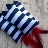 Catnip filled cat toy. Felt kitty ears and feather tail. Stripes.