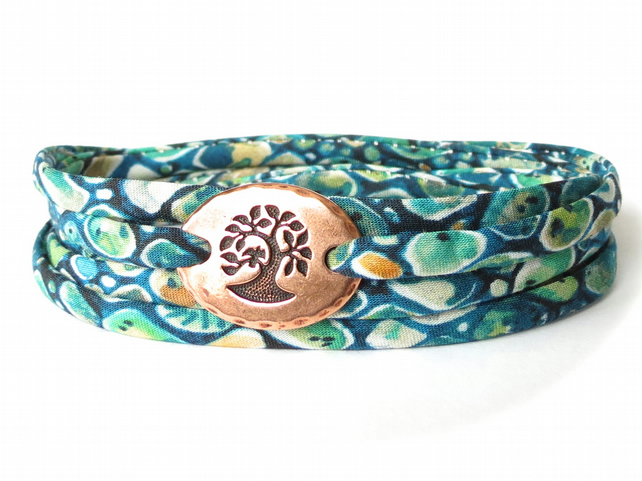 Liberty fabric wrap bracelet in teal with TierraCast bird in a tree link