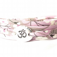 Yoga bracelet with pastel lilac and grey Liberty fabric and TierraCast Om charm