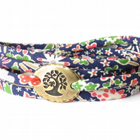 Pretty wrap bracelet with floral Liberty fabric in blue with tree charm