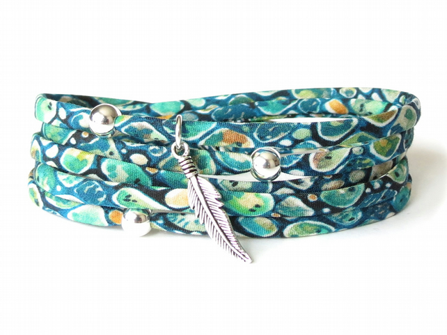 Bohemian silver feather charm bracelet with teal Liberty fabric