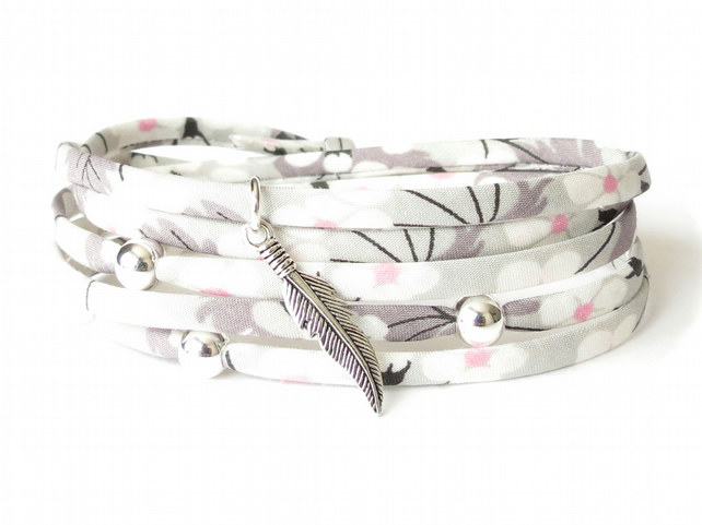 Silver feather charm bracelet with floral Liberty fabric in light grey