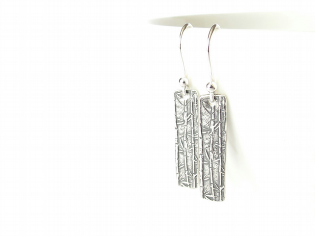 Rustic artisan silver earrings with bamboo and Chinese calligraphy detail