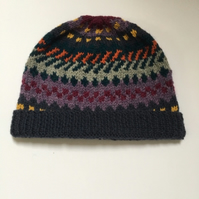 hand knitted hat in Lavender garden colours