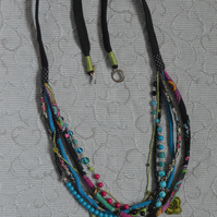Multi Strand Adjustable Fabric and Bead Necklace