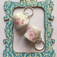 A Pair of Pink and White Ceramic Tea Cup Stitch Markers