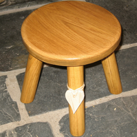 Lighter coloured style Oak topped wooden milking stool