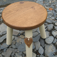 Oak topped wooden milking stool