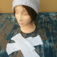 Lacy white hand-knitted hat and fingerless gloves
