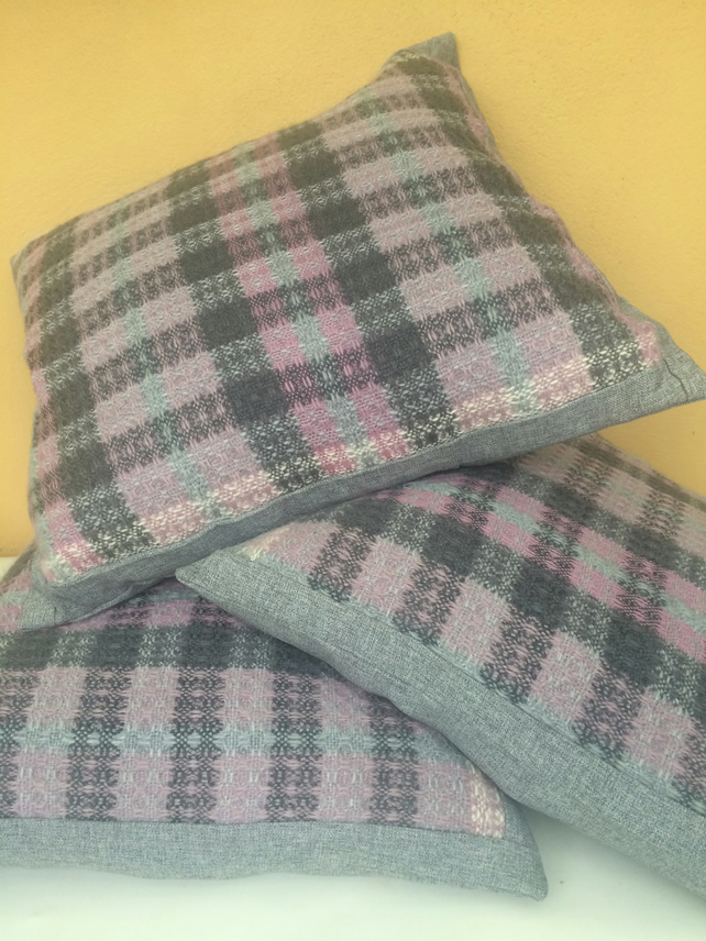 Hand woven cushions in heathery hues