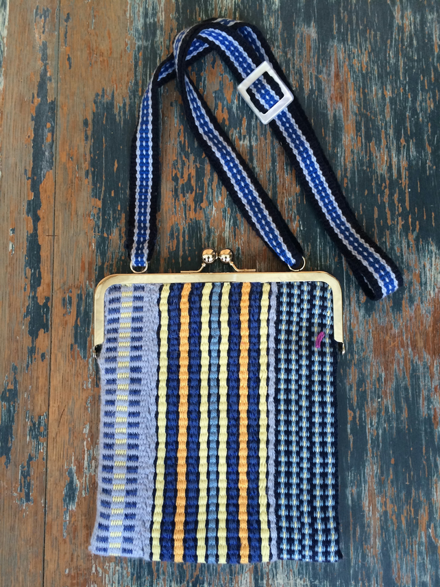 Striped bag with adjustable shoulder strap and vintage buckle