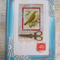 Original mixed media art on book. Blue white with vintage postcard & bird