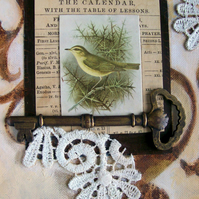 Original altered book art, mixed media. Bird, key, vintage postcard. Browns