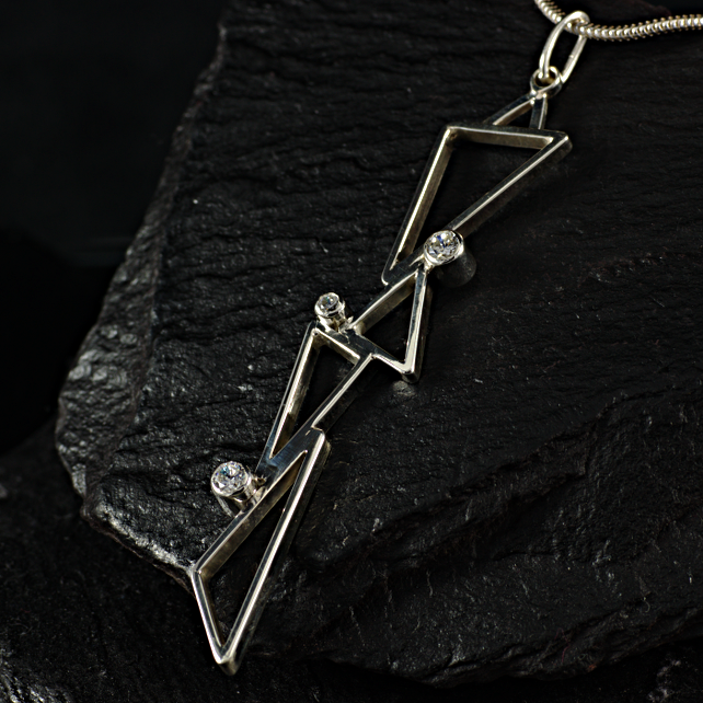 Sterling silver triangles and cubic zirconia pendant. (041)