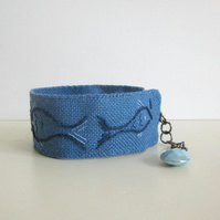 Little blue fish hand embroidered cuff bracelet