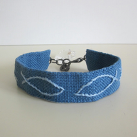 Sign of the fish blue hand embroidered cuff bracelet with crystal cross