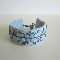 Cuff bracelet hand embroidered teal green on soft grey
