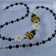 Lampwork glass bee and flower necklace with blue goldstone