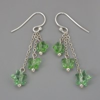 Three tier peridot green Swarovski flower, butterfly and star bead earrings