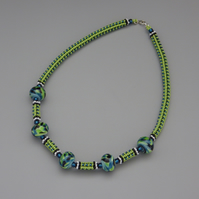 Bright green and blue beadwoven necklace with swirled UK lampwork beads
