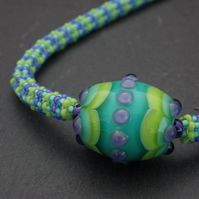 Green, turquoise and purple beadwoven necklace with pretty UK lampwork bead