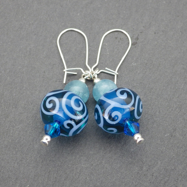 Blue swirling UK lampwork glass bead earrings with blue sponge quartz