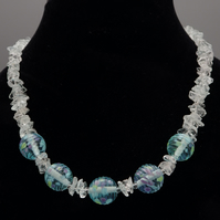 Frosty lampwork glass necklace with blue topaz chips