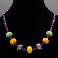 Dotty lampwork glass bead necklace with faceted amethyst semiprecious beads
