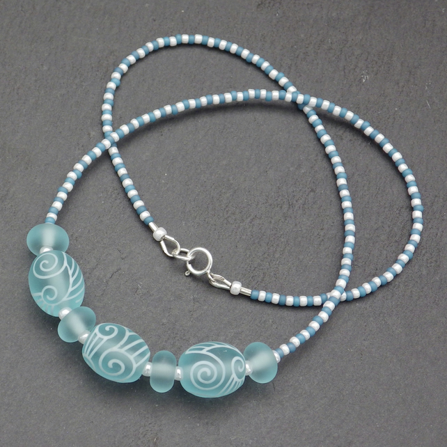 Aquamarine blue and white swirl lampwork glass bead necklace