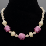 Rose pink fritty lampwork bead necklace with cream lampwork spacers and calcite