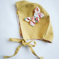 Yellow linen bonnet with fabric origami butterfly