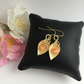Gold Plated Earrings with Soft Gold Plated Leaf and Coral Glass Bead