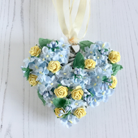 Wicker Mini Heart with Blue Silk Flowers and Yellow Paper Roses (4x4 inches)