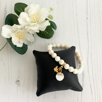 Cream Shell Bead Stretch Bracelet with Mother of Pearl and Bee Charms