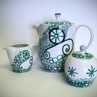 Hand decorated porcelain tea  or coffee set.