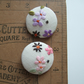 A pair of extra large buttons covered in vintage embroidery. Mothers' Day gift.