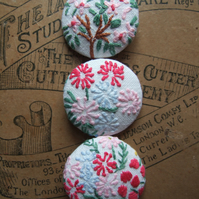 Three jumbo sizes buttons with vintage hand sewn embroidery