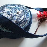 Circular shoulder bag in a vintage embroidery willow pattern plate design.