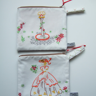 A matching pair of vintage embroidered purses. A Crinoline lady and her dovecot.