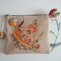 Homespun vintage embroidered crinoline lady zip up purse.