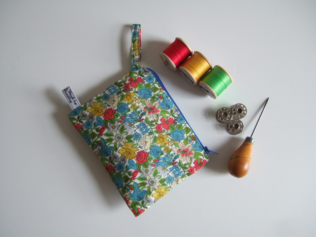Liberty bright floral fabric purse, makeup bag, or headphones storage bag.