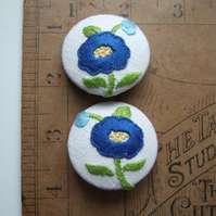 A pair of jumbo extra large buttons, covered with vintage hand sewn embroidery.