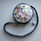 Round evening bag or occasions' bag with vintage embroidery from a plate design.