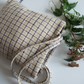 Woollen tote bag in a cream and beige checked design.